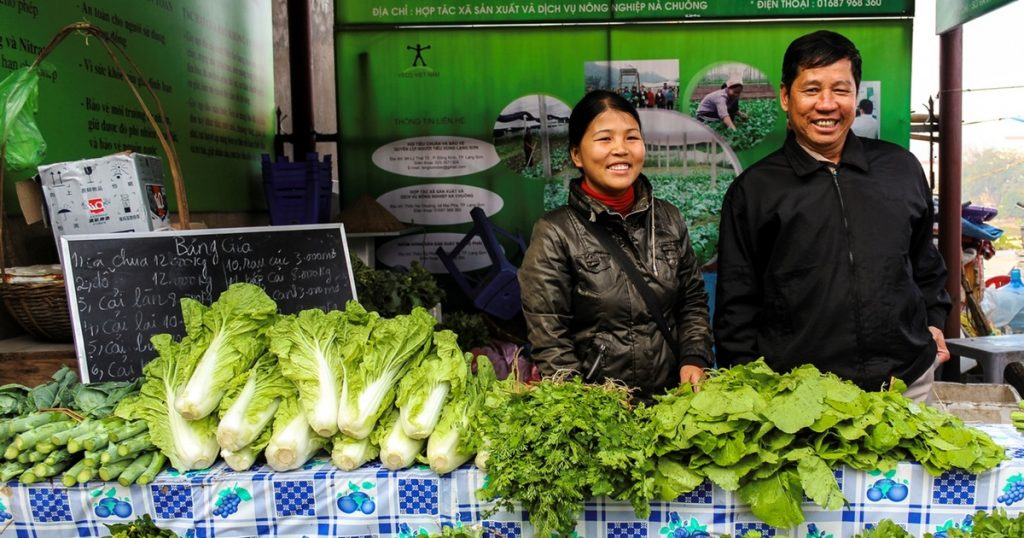 Sellers in street market selling fresh organic fruits and vegetables